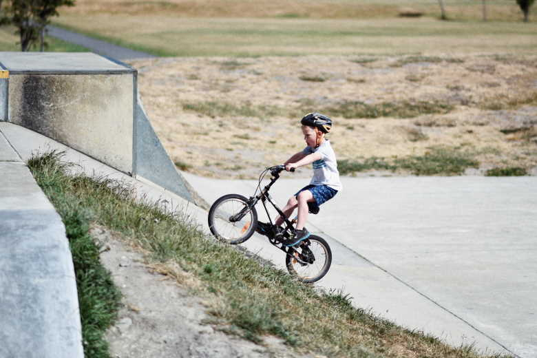 Child cycling up a hill