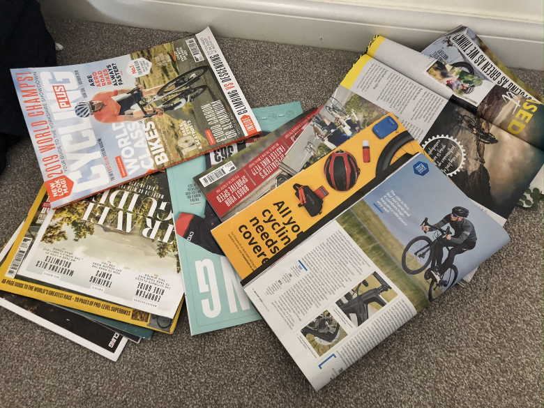 Cycling magazines in a pile